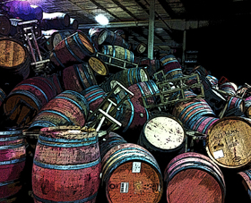 24 foot high stacks of wine barrels toppled over and collapsed into a soggy quagmire of metal, wood and wine.