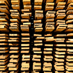 Wooden boards stacked at the timber yard. Texture
